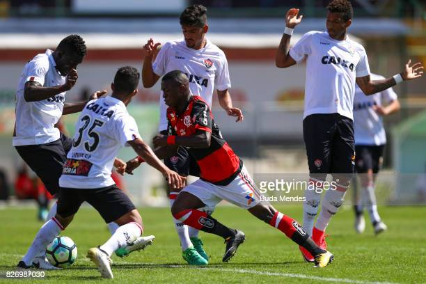 Vinicius Jr of Flamengo struggles for the ball with players of Vitoria during a match between Flamengo and Vitoria as part of Brasileirao Series A...