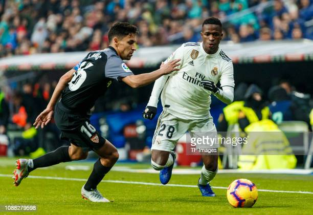 Vinicius Jr of Real Madrid and Jesus Navas of FC Sevilla battle for the ball during the La Liga match between Real Madrid and FC Sevilla at Santiago...