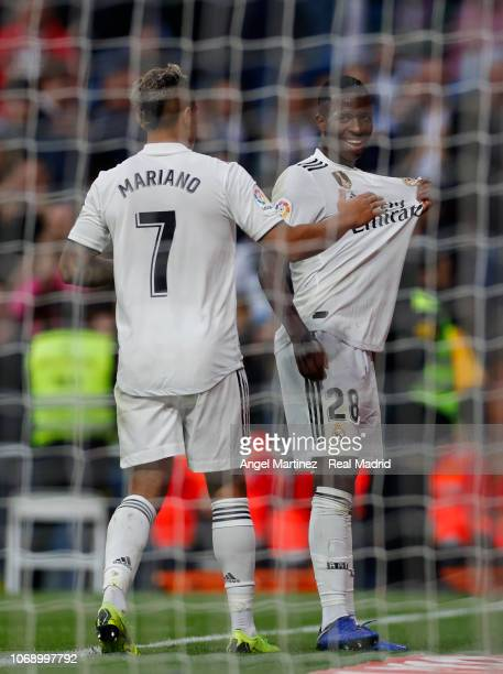 Vinicius Jr of Real Madrid celebrates with Mariano Diaz after scoring their team's fifth goal during the Copa del Rey fourth round second leg match...