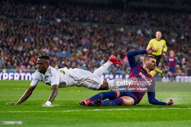 Vinicius Jr of Real Madrid CF battle for the ball with Gerard Pique of FC Barcelona during the Liga match between Real Madrid CF and FC Barcelona at...