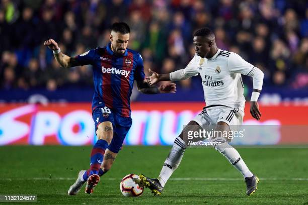 Vinicius Jr of Real Madrid CF competes for the ball with Erick Cabaco of Levante UD during the La Liga match between Levante UD and Real Madrid CF at...