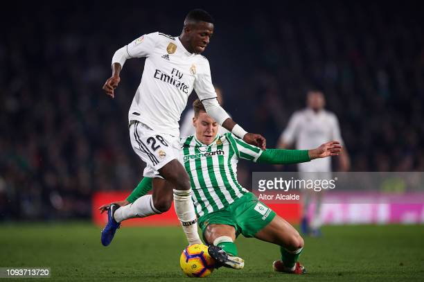 Vinicius Jr of Real Madrid CF competes for the ball with Francisco Javier Guerrero Francis of Real Betis Balompie during the La Liga match between...