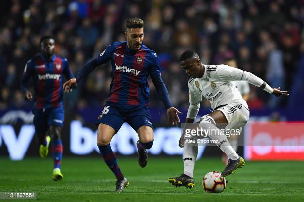 Vinicius JR of Real Madrid CF competes for the ball with Ruben Rochina of Levante UD during the La Liga match between Levante UD and Real Madrid CF...