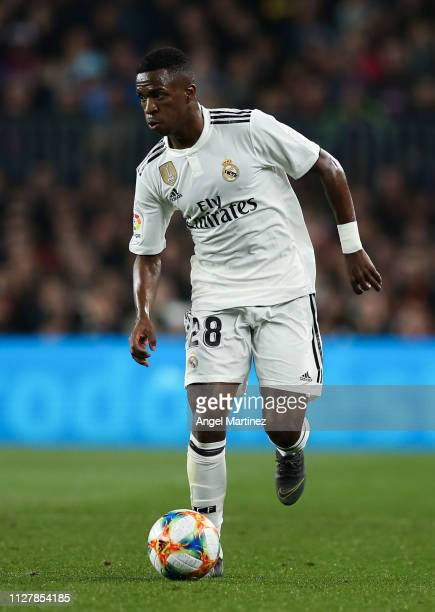 Vinicius JR of Real Madrid CF runs with the ball during the Copa del Semi Final first leg match between Barcelona and Real Madrid at Nou Camp on...