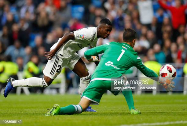 Vinicius Jr of Real Madrid competes for the ball with Pedro Luis Moreno of Melilla during the Copa del Rey fourth round second leg match between Real...