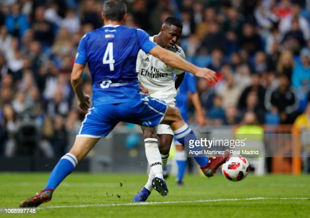 Vinicius Jr of Real Madrid scores his team's fifth goal past Richi Segura of Melilla during the Copa del Rey fourth round second leg match between...