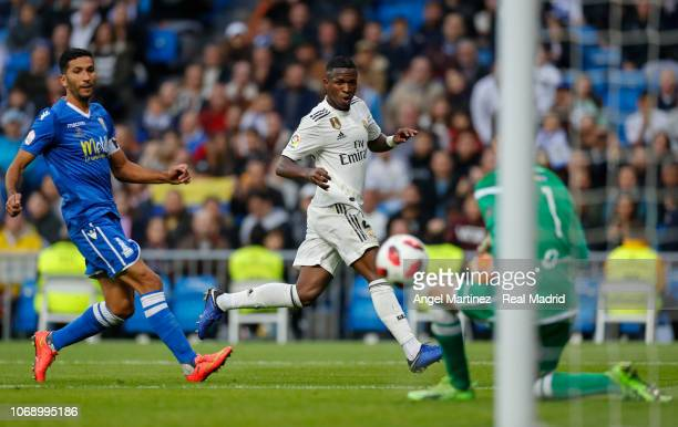 Vinicius Jr of Real Madrid shoots on goal past Pedro Luis Moreno of Melilla during the Copa del Rey fourth round second leg match between Real Madrid...
