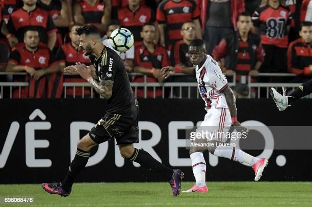 Vinicius Junior of Flamengo battles for the ball with João Lucas of Ponte Preta during the match between Flamengo and Ponte Preta as part of...