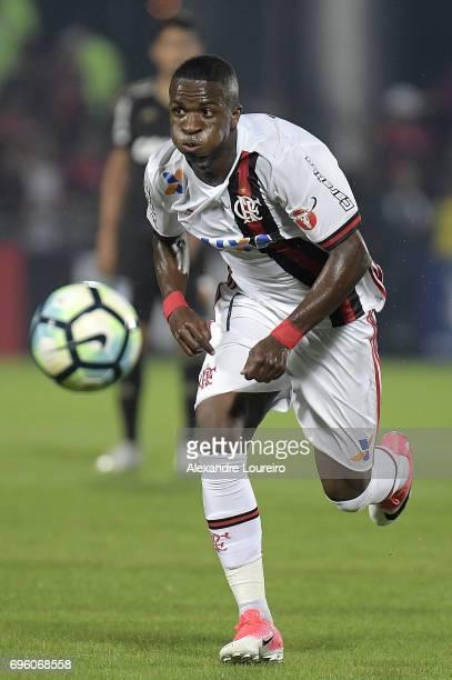 Vinicius Junior of Flamengo runs with the ball during the match between Flamengo and Ponte Preta as part of Brasileirao Series A 2017 at Ilha do...