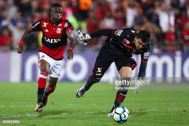 Vinicius Junior of Flamengo struggles for the ball with goalkeeper Felipe of Atletico GO during a match between Flamengo and Atletico GO part of...