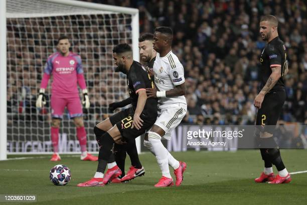 Vinicius Junior of Real Madrid argues with Riyad Mahrez of Manchester City during the UEFA Champions League round of 16 first leg soccer match...