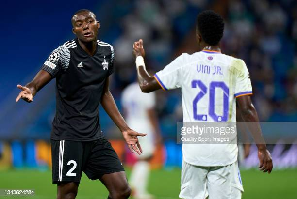 Vinicius Junior of Real Madrid argues wth Danilo Arboleda of FC Sheriff during the UEFA Champions League group D match between Real Madrid and FC...