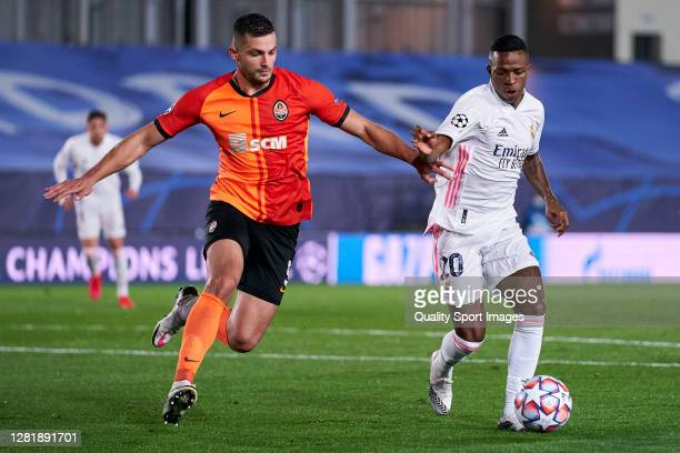 Vinicius Junior of Real Madrid battle for the ball with Davit Khocholava of Shakhtar Donetsk during the UEFA Champions League Group B stage match...