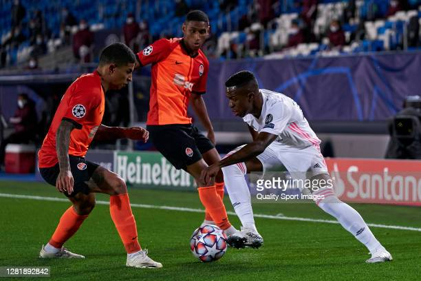 Vinicius Junior of Real Madrid battle for the ball with Dodo of Shakhtar Donetsk during the UEFA Champions League Group B stage match between Real...
