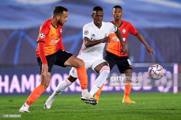 Vinicius Junior of Real Madrid battle for the ball with Maycon of Shakhtar Donetsk during the UEFA Champions League Group B stage match between Real...