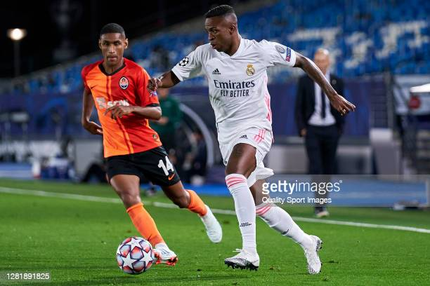 Vinicius Junior of Real Madrid battle for the ball with Tete of Shakhtar Donetsk during the UEFA Champions League Group B stage match between Real...