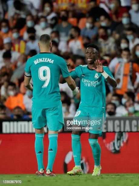 Vinicius Junior of Real Madrid celebrates 1-1 with Karim Benzema of Real Madrid during the La Liga Santander match between Valencia v Real Madrid at...