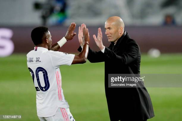 Vinicius Junior of Real Madrid Celebrates 3-1 with coach Zinedine Zidane of Real Madrid during the UEFA Champions League match between Real Madrid v...