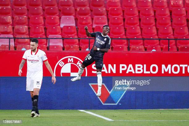 Vinicius Junior of Real Madrid celebrates after his team's first goal, an own goal by Yassine Bounou of Sevilla during the La Liga Santander match...