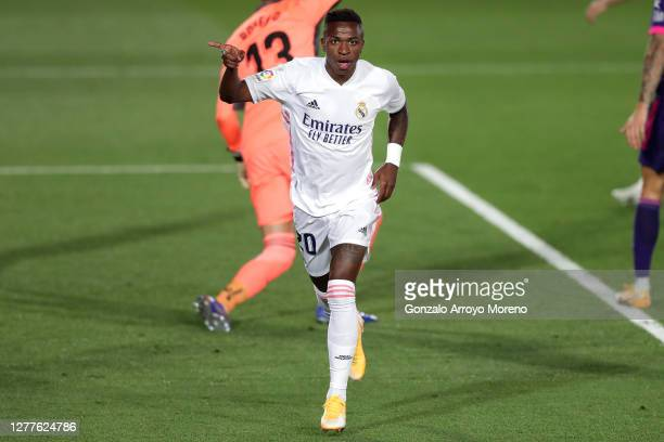 Vinicius Junior of Real Madrid celebrates after scoring his team's first goal during the La Liga Santander match between Real Madrid and Real...