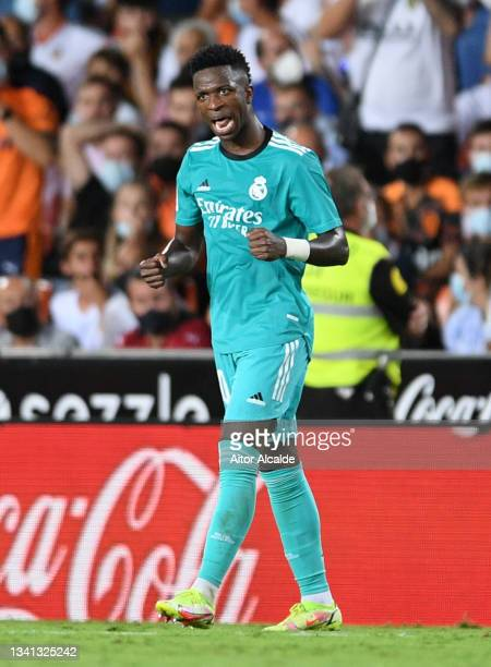 Vinicius Junior of Real Madrid celebrates after scoring their side's first goal during the La Liga Santander match between Valencia CF and Real...