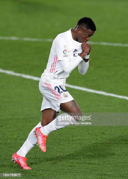 Vinicius Junior of Real Madrid celebrates after scoring their team's first goal during the La Liga Santander match between Real Madrid and Real...
