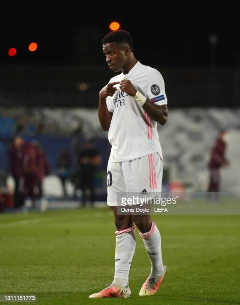Vinicius Junior of Real Madrid celebrates after scoring their team's first goal during the UEFA Champions League Quarter Final match between Real...