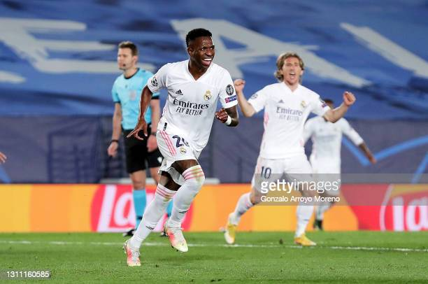Vinicius Junior of Real Madrid celebrates after scoring their team's third goal during the UEFA Champions League Quarter Final match between Real...