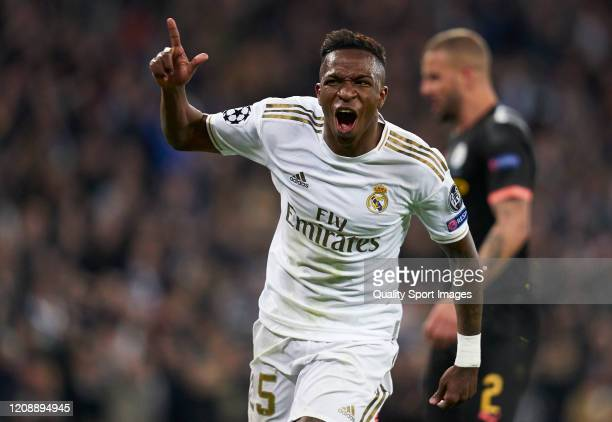 Vinicius Junior of Real Madrid celebrates after the first goal of his team scored by Isco Alarcon during the UEFA Champions League round of 16 first...