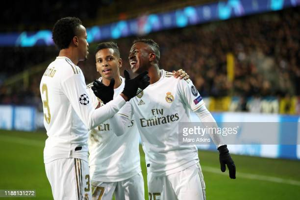 Vinicius Junior of Real Madrid celebrates his goal with Eder Militao and Rodrygo during the UEFA Champions League group A match between Club Brugge...