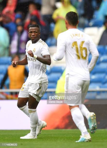 Vinicius Junior of Real Madrid celebrates his team's third goal with James Rodriguez of Real Madrid during the La Liga match between Real Madrid CF...