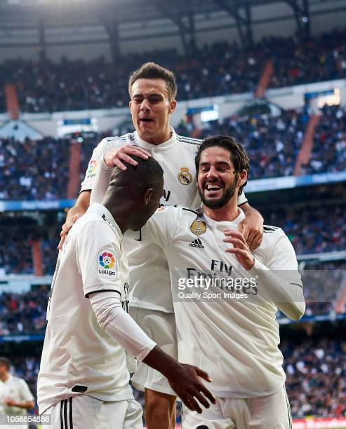 Vinicius Junior of Real Madrid celebrates scoring his team's opening goal with team mates during the La Liga match between Real Madrid CF and Real...