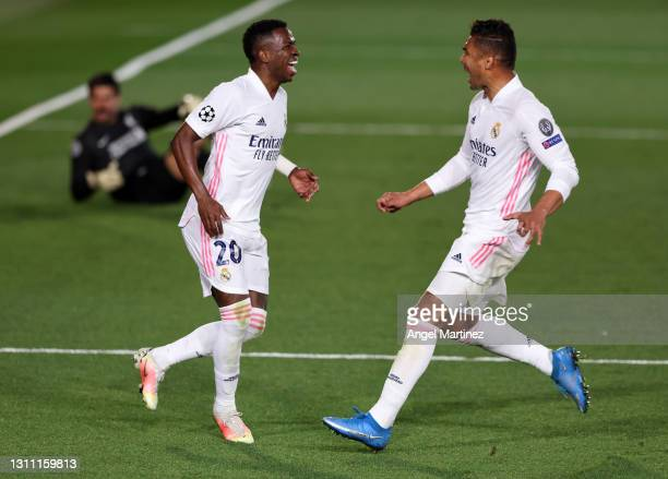 Vinicius Junior of Real Madrid celebrates with teammate Casemiro after scoring their team's third goal during the UEFA Champions League Quarter Final...