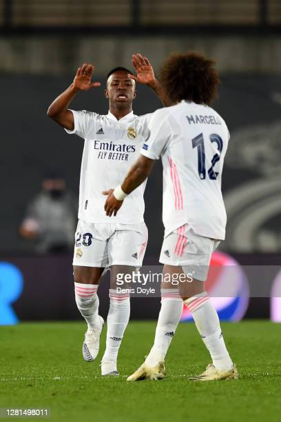 Vinicius Junior of Real Madrid celebrates with teammate Marcelo after scoring his sides second goal during the UEFA Champions League Group B stage...