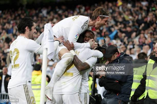 Vinicius Junior of Real Madrid celebrates with teammates Daniel Carvajal Isco and Sergio Ramos of Real Madrid after scoring his team's first goal...