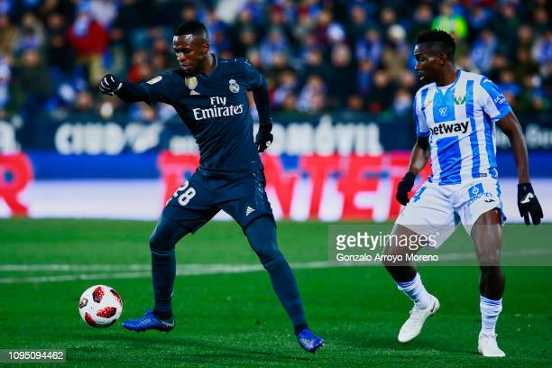 Vinicius Junior of Real Madrid CF competes for the ball with Kenneth Omeruo of Deportivo Leganes during the Copa del Rey Round of 16 second leg match...