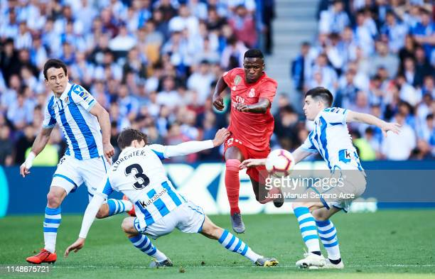 Vinicius Junior of Real Madrid CF duels for the ball with Diego Llorente of Real Sociedad during the La Liga match between Real Sociedad and Real...