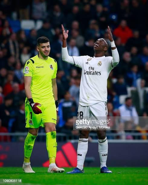 Vinicius Junior of Real Madrid CF protest ahead goalkeeper Geronimo Rulli of Real Sociedad de Futbol during the La Liga match between Real Madrid CF...
