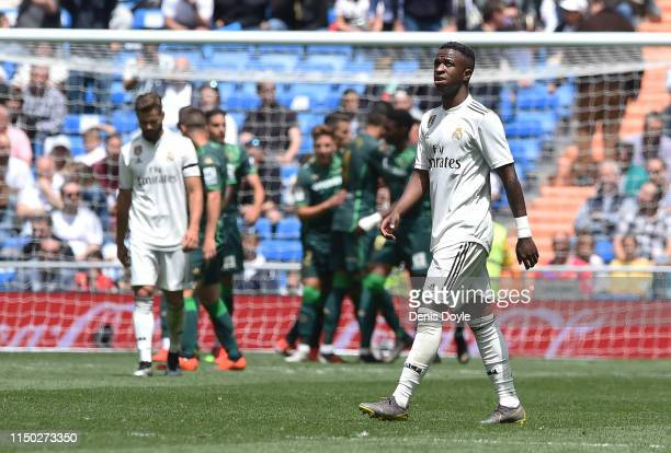 Vinicius Junior of Real Madrid CF reacts after Real Betis Balompie scored their 2nd goal during the La Liga match between Real Madrid CF and Real...
