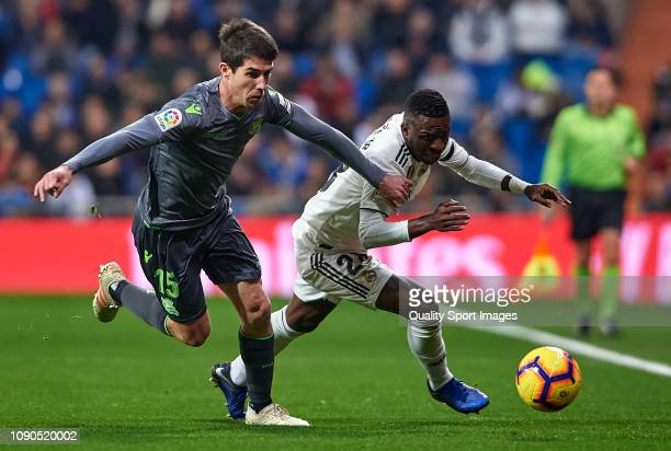 Vinicius Junior of Real Madrid competes for the ball with Aritz Elustondo of Real Sociedad during the La Liga match between Real Madrid CF and Real...