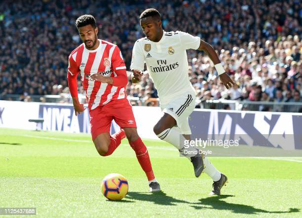 Vinicius Junior of Real Madrid gets past Jonas Ramalho of Girona during the La Liga match between Real Madrid CF and Girona FC at Estadio Santiago...