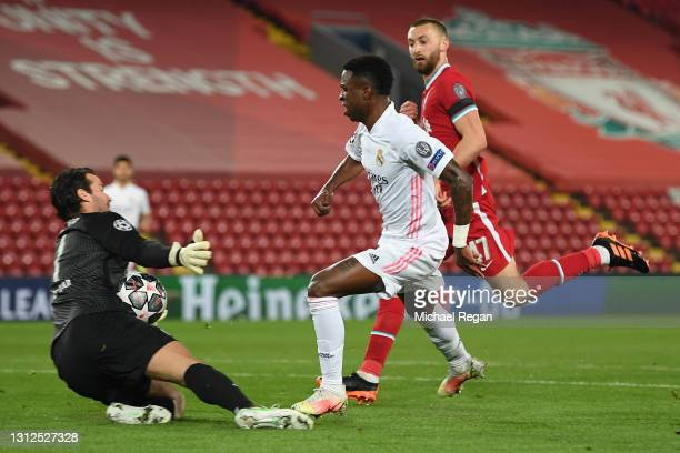 Vinicius Junior of Real Madrid has a shot saved by Alisson of Liverpool during the UEFA Champions League Quarter Final Second Leg match between...