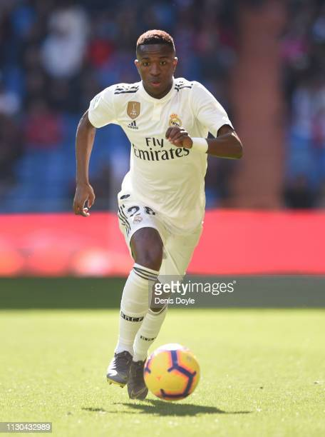 Vinicius Junior of Real Madrid in action during the La Liga match between Real Madrid CF and Girona FC at Estadio Santiago Bernabeu on February 17...