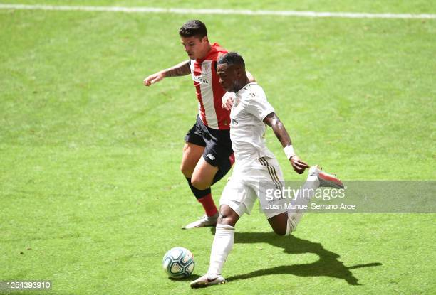 Vinicius Junior of Real Madrid is challenged by Ander Capa of Athletic Club during the La Liga match between Athletic Club and Real Madrid CF at San...