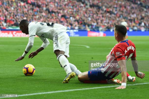 Vinicius Junior of Real Madrid is fouled by Jose Gimenez of Atletico Madrid for a penalty during the La Liga match between Club Atletico de Madrid...