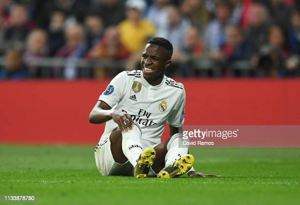 Vinicius Junior of Real Madrid is injured during the UEFA Champions League Round of 16 Second Leg match between Real Madrid and Ajax at Bernabeu on...