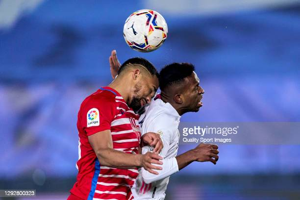 Vinicius Junior of Real Madrid jumps for the ball with Yangel Herrera of Granada CF during the La Liga Santander match between Real Madrid and...