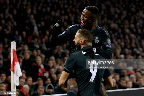 Vinicius Junior of Real Madrid Karim Benzema of Real Madrid celebrate 01 during the UEFA Champions League match between Ajax v Real Madrid at the...
