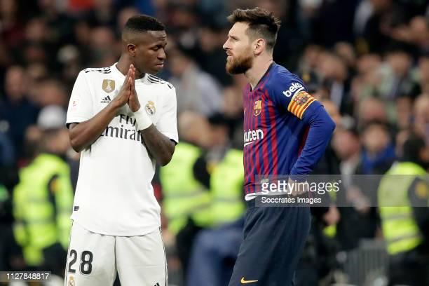 Vinicius Junior of Real Madrid Lionel Messi of FC Barcelona during the Spanish Copa del Rey match between Real Madrid v FC Barcelona at the Santiago...