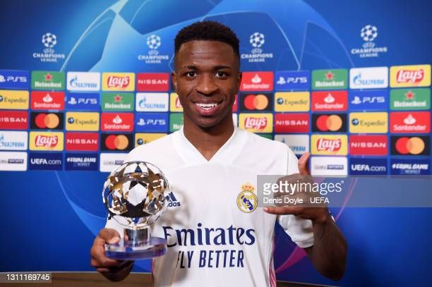 Vinicius Junior of Real Madrid poses for a photo with the UEFA Player of The Match award following his team's victory in the UEFA Champions League...